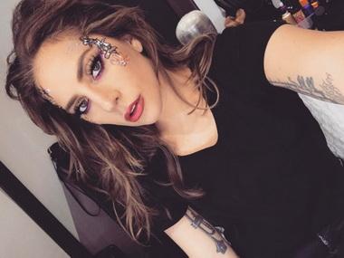 Леди Гага с коричневыми волосами.